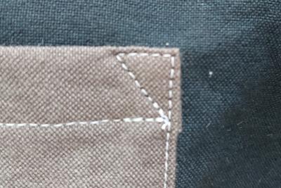 ポケット口の補強の三角
